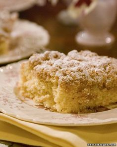 New York Crumb Cake ~ 2 tablespoons canola oil, plus more for pan; 4 cups all-purpose flour, plus more for pan; 1/2 cup granulated sugar; 2 1/2 teaspoons baking powder; 1/2 teaspoon salt; 1 large egg; 1/2 cup milk; 2 teaspoons pure vanilla extract; 1 cup packed light-brown sugar; 1 1/2 teaspoons ground cinnamon; 1 cup (2 sticks) unsalted butter, melted and cooled; Confectioners' sugar, for dusting