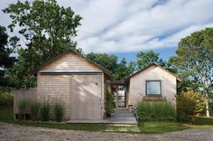 A bike shed and a guest house compose the home's street elevation. Estes Twombly Architects