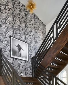 Looking back on the @traditionalhome @dallasshowhouse! This artwork had us dancing up those stairs too! Were always looking for creative ways to add movement to our clients spaces
