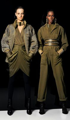 Modern interpretation: Pre-Fall 2014 Balmain Fashion Fall 2014. These outfits are inspired by by WWII. The model on the right wears a jumpsuit much like that of WWII jumpsuit worn by women in the early 1940s.