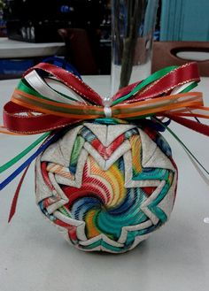 Folded fabric Christmas Ornament - Multi Color swirl Coordinating ribbon sets it off and makes it unique. Back is the same pattern/look as Quilted Christmas Ornaments, Beaded Ornaments, Ornament Crafts, Christmas Items, Handmade Christmas, Ball Ornaments, Christmas Balls, Christmas 2016, Quilted Fabric Ornaments