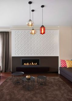 Chic contemporary coffee tables in black and colorful pendant lighting for the lighting