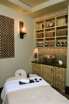 Natural healing treatment room:  oils, hot stones, massage, acupuncture