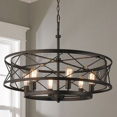 "Sophisticated urban style incorporates a modern cage design with metal X bar detailing. (23.5""H x 32""W)6-100 Watt medium base sockets.Chain Length: 10'Wire Length: 15'Canopy: 6""W"