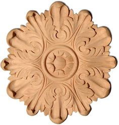 Wood rosettes and small carvings. Wood rosettes and small carvings are great embellishments for custom cabinets, furniture and walls. Wood rosettes are carved from hardwood Fireplace Update, Fireplace Mantels, Wood Rosettes, Art Studio Storage, House Trim, Inviting Home, Wood Plaques, Wooden Crafts, Custom Cabinets