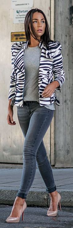 casual glam look with zebra print moto jacket, jeans, and nude pumps