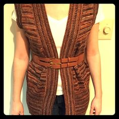 Cool vintage multicolored vest! One of my favorite vintage finds! This vest has an awesome orange, white, black, brown, and grey mini stripe, making it match well with so many colors. It looks great over a turtleneck for a boho, vintage vibe, or over a button-up for a more sophisticated look. It has no tag so I don't know what brand or material it is. It's really soft and definitely machine washable though! Vintage Sweaters
