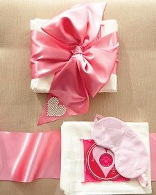 """Sweet Dreams"" care package with a pair of super-soft flannel pillowcases, a quilted-satin eye mask, and a compilation of lullabies. It's all wrapped up in a giant satin bow with a sparkly stick-on heart. A bff gift"