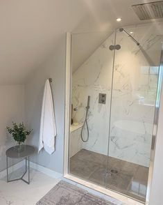 has designed this beuatifully simplistic shower room ensuite. We love the light coloured scheme and marble shower wall. Loft Ensuite, Loft Bathroom, Bathroom Plans, Ensuite Bathrooms, Bathroom Renos, Bathroom Layout, Bathroom Interior Design, Bathroom Ideas, Marble Bathrooms