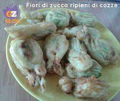 """http://blog.giallozafferano.it/lacucinadimilena/fiori-di-zucca-ripieni-di-cozze/ La ricetta dei  fiori di zucca ripieni di cozze me l'ha gentilmente data Maria Ersilia Lerro,iscritta come me,alla pagina Facebook  """"Napoletani che la domenica pubblicano le foto di quel che hanno cucinato"""". In questa pagina noi partenopei,ma anche chi si sente napoletano,pubblichiamo le foto dei piatti che si preparano per il pranzo della domenica e non solo."""