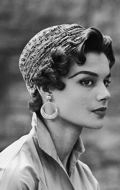 Love the subtly hint of gypsy style in this look from 1953. #vintage #fashion #hair #1950s