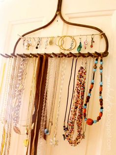Jewelry Display from a Rake, you probably have one in the shed. :-)