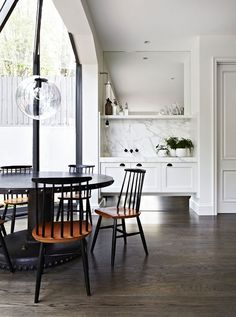 Again b and w and wood (paint damaged top of our round table black and get black chairs for kitchen???