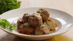 See how to make amazing meatballs with ground beef, veal, and pork.