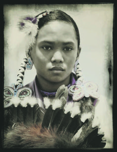Josie Lenwell of Taos took first place in the 'People' category in the 13th annual New Mexico Magazine photo contest for this image titled 'Powwow Princess in Full Regalia,' taken of Mikayla Johnson at the 2013 Taos Pueblo Powwow.