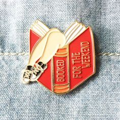 Because reading is sexy! Details: 1 inch tall x 1 inch wide Booked For the Weekend Book Lover Enamel Pin Soft enamel Gold base color Ships as a single pin on small pin backing (business card size) Jacket Pins, Literary Gifts, Book Jewelry, Blue Books, Pin And Patches, Jacket Patches, Cute Pins, Party Bags, Luxury Bags
