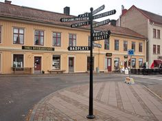 Signposts on the square pointing to bathing place, library etc. - Ett torg med skyltar till badplats, bibliotek m. Places Ive Been, Bathing, Mansions, House Styles, Photo Illustration, Bath, Villas, Bathrooms, Palaces