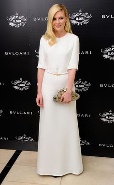 "Kirsten Dunst in Derek Lam dress and clutch ""Aida"" by Bvlgari."