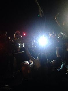 Riot police aiming guns at journalists who are on the ground and holding their hands in the air. #Ferguson -What in the G-Damn hell?