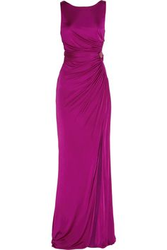 Elegantly ruched at the waist for a flattering fit, Roberto Cavalli's fluid silk-jersey gown is sure to turn heads this party season. Elevate this dark-fuchsia piece to new fashion heights with metallic platforms and a satin clutch.