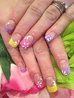 Multicoloured lilac, pink and yellow glitter acrylic tips with white flower nail art