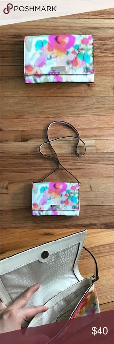 kate spade floral print crossbody Carry this super cute crossbody purse this summer with a splash of print and color. White leather strap, monogram Kate Spade lining, pocket inside and gold hardware. Great condition and only used a handful of times. kate spade Bags Crossbody Bags