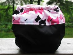 Cloth diaper I sewed from black PUL and Cotton from Ann Kelle for RK (pink scotty dogs) lined with pink minky dot and has pink snaps (we have a black scotty and a white westie!! so this is perfect for my 3rd baby) #sew # diaper # cloth #homemade #baby #make #scottie #scotty #dog #ann kelle #robert kaufman #urban #urban zoologie #zoology #westie #remix