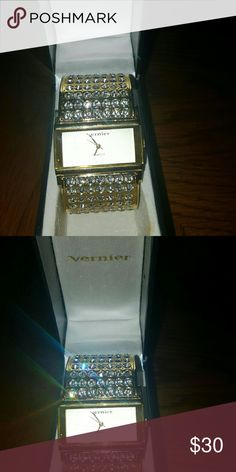 Vernier Gold w Gemstones Statement Watch Great gift idea! Beautiful! Make a statement w this watch! It needs a new battery but all gemstones are in tack.... Comes w the original box.... Feel free to ask any questions like additional pictures ✅Make an offer through OFFER button ONLY ✅Negotiations welcome ❌NO DISCUSSING PRICE IN COMMENTS ❌No trades ❌No PayPal ✴Bundles encouraged✴ Vernier Accessories Watches