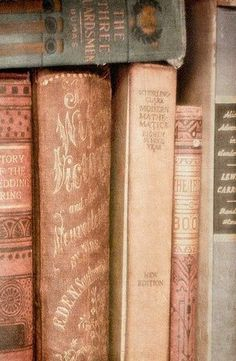 books in pinks and gold