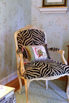 "Love the ""traditional"" pillow against the   unexpected modern animal print on a french style (faux antique) chair. Wonderful.  Sincerely, JoAnne Craft"