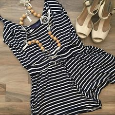 Navy & White Striped Romper Adorable navy and white stripe romper. Original tags.  Ties at the waist. Love Lucy Love Shorts