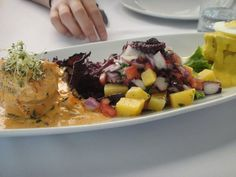 Combination plate of seafood, ceviche and papa a la huancaina.
