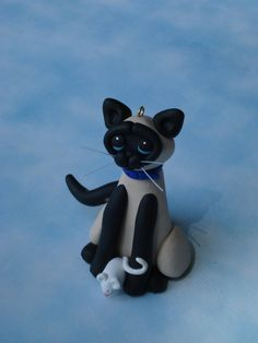 Siamese cat figurine ornament polymer clay art sculpture handcrafted cat and mouse. $12.50, via Etsy.