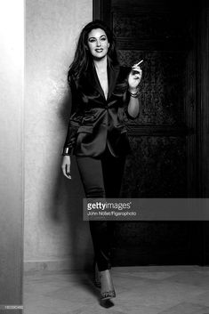 Actress Monica Bellucci is photographed for Madame Figaro on December 2012 in Marrakech, Morocco. Suit by Dolce & Gabbana, cuff and bracelets by Cartier, shoes by Jimmy Choo. Make-up by Dolce & Gabbana. Smoking Ladies, Girl Smoking, Monica Bellucci, Women Smoking Cigarettes, She's A Lady, Bond Girls, Italian Actress, Italian Beauty, Girls World