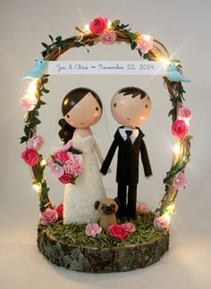 this listing is for one custom handmade wedding cake topper with wood slab base & arch with fairy lights. pets not included.    *please read the