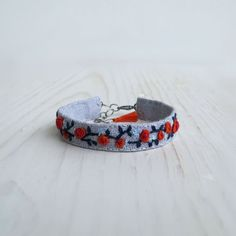 Hand Embroidered Fabric Cuff Bracelet Orange and Blue by Sidereal