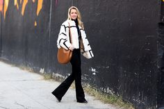 """""""If I could live in a decade of style, the '70s would be my pick—flattering flares, long hair, and bohemian vibes are my sartorial obsessions. Instead of taking it so literally this season, I am adding a polished aspect to the groovy look. Graphic fur dolman coat, black (not blue) jeans and a sleek gold pendant and hobo bag that read more urbane in silhouette."""" Mother Denim jeans, $198, shopBAZAAR.com; J Brand turtleneck, $195, jbrandjeans.com; Chloe coat, $16,650, neimanmarcus.com. Chloe…"""