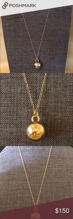14k solid gold w/authentic LouisVuitton ball charm 14k solid gold w/ authentic Louis Vuitton ball with LV stamp.  Pendant come from authentic Louis Vuitton charm. It is made out of brass. The charms is used but excellent condition, it has been polished to perfection! Size: 1/2 inch Chain non-LV, but it is 14k solid gold, 18 inches long. Buy with confidence! See my ratings for reference! I do accept for reasonable offers! Thank you Louis Vuitton Accessories
