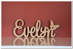 Custom made freestanding wooden name Evelyn with a butterfly. Made in raw(unpa. Wooden Names, Custom Made, Butterfly, Neon Signs, Royce, How To Make, Link, Stall Signs, Butterflies