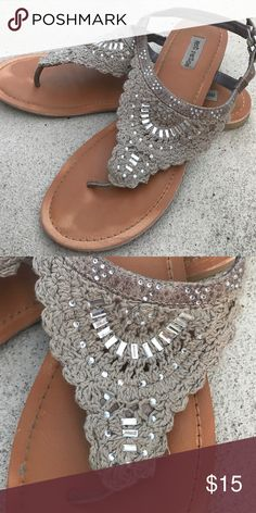 NotRated tan sandals. Not Rated tan sandals.  Tan lace look with some rinestone details.  Worn well- shows on sole in pictures but still have lots of life in them! Size 10 Not Rated Shoes Sandals