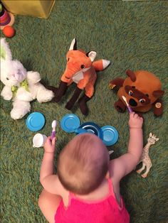 Pretend play, feeding animals, activities for one year old, development promoting activities for toddlers, toddler games, activities for 12 month old, activities for 13 month old, activities for 14 month old, activities for 15 month old, activities for 16 month old, activities for 17 month old, activities for 18 month old, games for toddler