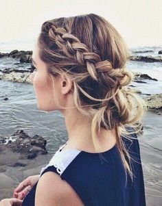 dutch accent braid into a messy low bun for a cute casual hairstyle on brunette hair with blonde highlights