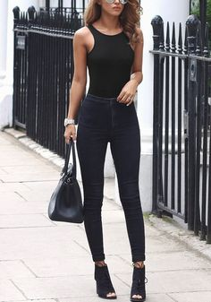 black ribbed low-back bodysuit worn with black skinnies