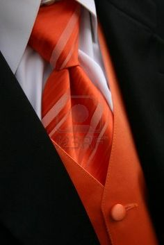 A closeup image of an orange tie, vest and tux. I really do like this!