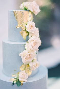 Light blue wedding cake, gold foil, cascading pink roses, unique wedding cake design, pin to your own inspiration board // Melanie Gabrielle