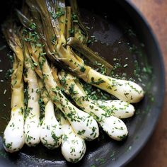 Onion flavor is layered in this dish: The greens have a brightness to balance the bulbs' sweetness, the cooking liquid becomes a buttery sauce, and fresh chives deliver a high note to finish.