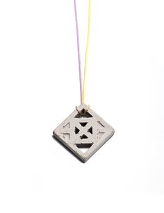 Concrete Jewelry, industrial design. Traditional wearing tiles.