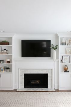 Looking to update your old fireplace? This step-by-step process takes you through how we transformed our old fireplace into a white marble tile fireplace that we absolutely love. Built In Around Fireplace, Tv Over Fireplace, Fireplace Update, Fireplace Bookshelves, Fireplace Built Ins, Fireplace Remodel, Living Room With Fireplace, Fireplace Surrounds, Fireplace Design