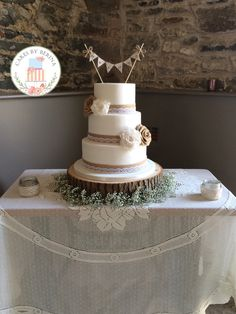 Rustic vintage wedding cake with hand made lace and hessian roses