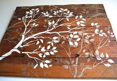 Old barnwood   stencils . I love how they used the same stencil but different color/ intensity of paint in the overlapping design. Would be a beautiful headboard!